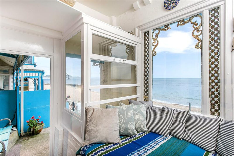 The Snug area with views of the beach and sea