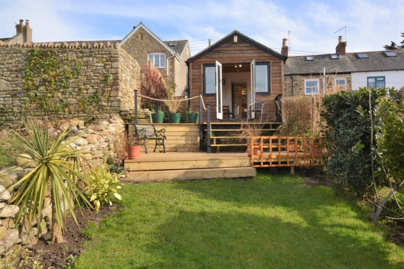 Looking towards the detached property from the enclosed garden