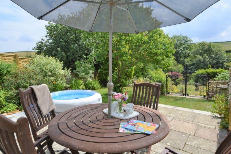 Beautiful enclosed garden with furniture and BBQ