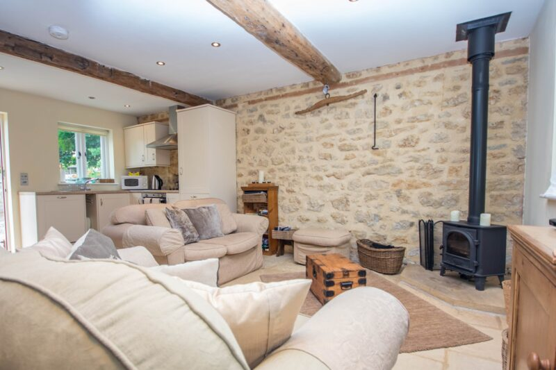 Light and stylish open-plan lounge/kitchen/diner with cosy wood burner