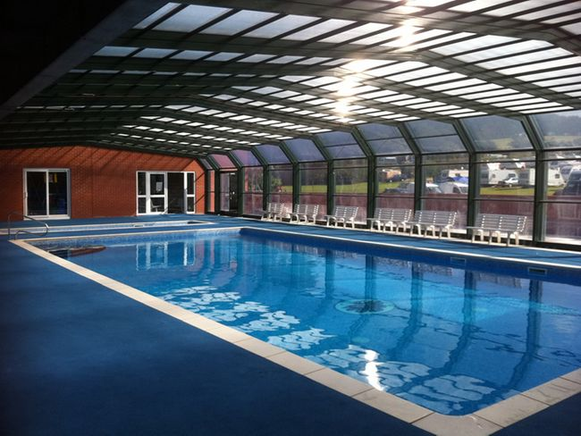Shared covered outdoor heated swimming pool
